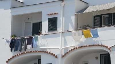 Balconies of Neighboring Apartments at Residential House, Laundry Drying in Wind