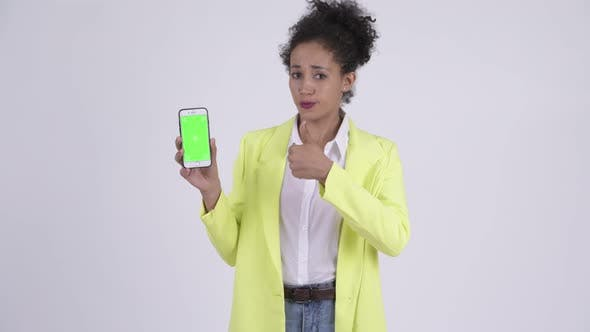 Thumbnail for Happy Young Beautiful African Businesswoman Showing Phone and Giving Thumbs Up