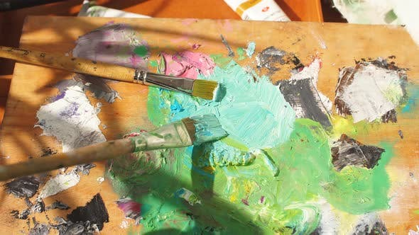Thumbnail for Young Stylish Woman Mixing Colors Before Painting