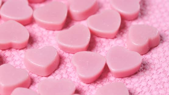 Pink chocolate on pink background