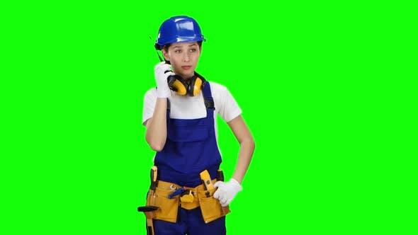 Thumbnail for Engineer Girl Wearing Wearing Talks on the Walkie Talkie. Green Screen