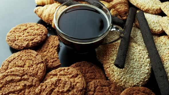 Thumbnail for Mug of Coffee with Oatmeal Cookies and Croissants