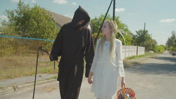 Thumbnail for Couple in Halloween Costumes Trick or Treating Outdoors