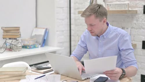 Stressful Businessman Reading Documents