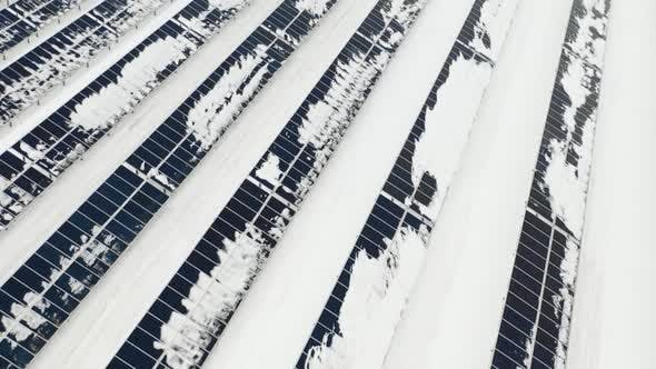Thumbnail for Flying Over the Farm Solar Panels in the Winter After the Cyclone. Panels Under the Snow.
