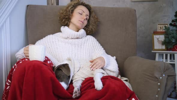 Thumbnail for Young Woman And Dog Sleeping On Chair At Home, Cozy Winter Holiday Concept