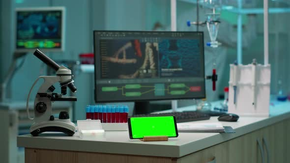 Thumbnail for Scientist Using Smartphone with Green Screen Placed on Desk
