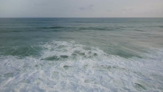 Thumbnail for Drone Moving Left Over Big Wild Blue Ocean Waves Reaching the Shore and Crashing Down with White