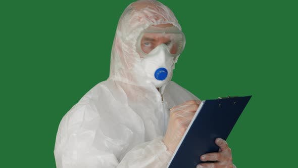 Thumbnail for Medical Worker in Protective Costume and Mask Writing on Clipboard. Bio Engineer in Safety Suit