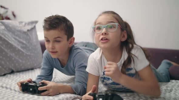Thumbnail for Happy Kids Win Video Game at Home