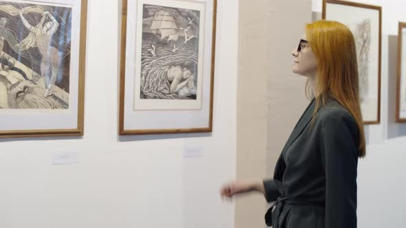 Thumbnail for Woman Looking at Pictures in Art Gallery
