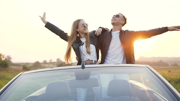 Thumbnail for Stylish Young Couple Enjoying Beautiful Landscape During Rest After Trip in the Cabriolet
