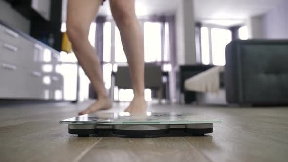 Thumbnail for Female Legs on Scale and Celebrating Weight Loss