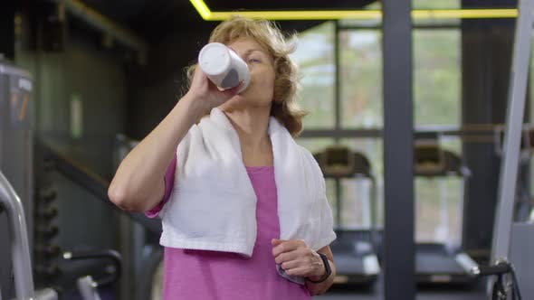 Thumbnail for Old Woman after Training in Gym