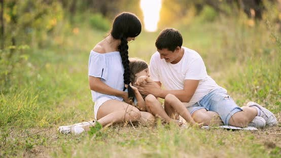 Mom and Dad Tickling Baby