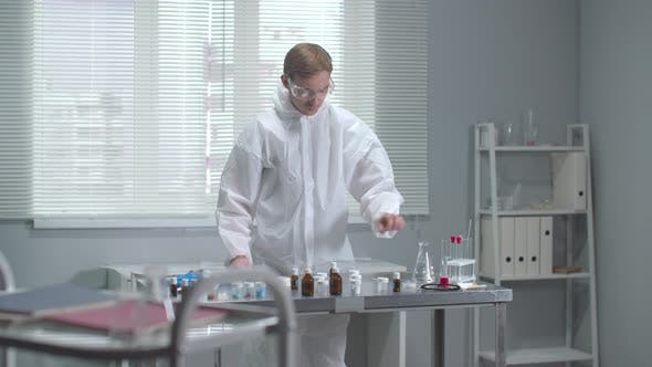 Thumbnail for Man in Protective Workwear Check Chemical Test Tube in the Laboratory
