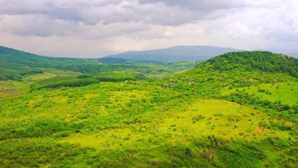Thumbnail for Drone Flies Above on Mountain Land in Rainy Day