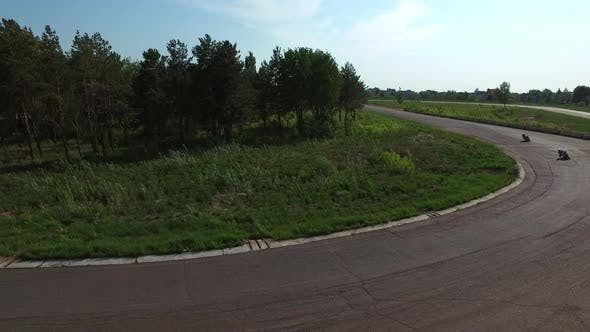 Thumbnail for Sport Motorcycles Riding on Race Track. Aerial View Group Motorcycle