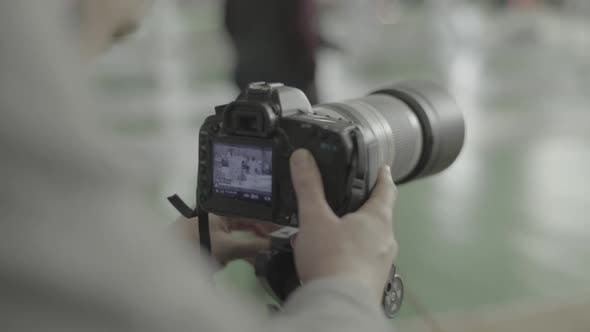Thumbnail for A Photographer (Cameraman) Shoots for Fencing Competitions. Slow Motion. Kyiv