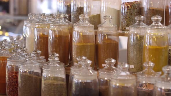 Thumbnail for Variety of Spices in Glass Jars in Food Market