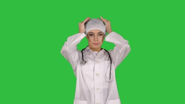 Cover Image for Medical doctor with stethoscope putting medical hat or
