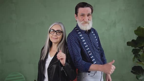 Thumbnail for Modern Retired Couple which  Posing on Camera with Thumbs Up