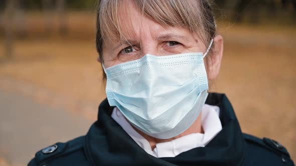 Thumbnail for Portrait of a Senior Woman in a Respirator Protection Mask