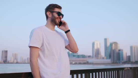 Thumbnail for A Man in Summer Sunglasses Talking on the Phone