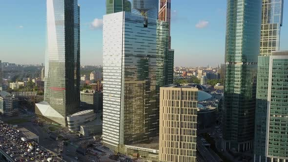 Thumbnail for A Vertical Inspection of Beautiful Skyscrapers Near the Busy Highway