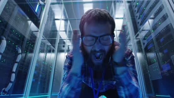 Thumbnail for Grimacing IT Engineer in Server Room