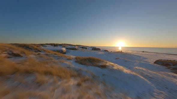 Drone Shot in FPV Along the Snowy Terrain Along the West Coast