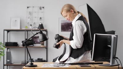 Female Photographer Sitting at Office
