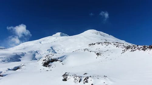 Stunning Aerial View of Mount Elbrus with Snowwhite Fields and Glaciers in Sunny Weather