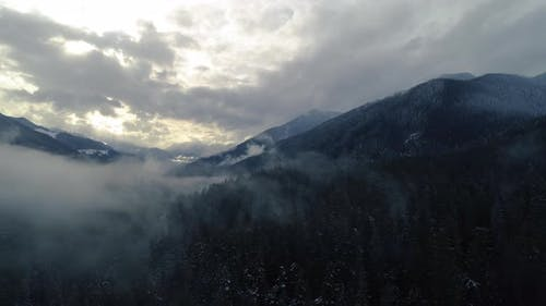 Drone Hyper Lapse Of Dramatic Cloud Movement In Mountain Forest