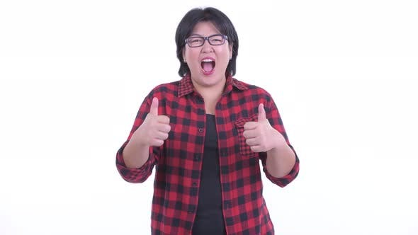 Thumbnail for Happy Overweight Asian Hipster Woman Giving Thumbs Up and Looking Excited