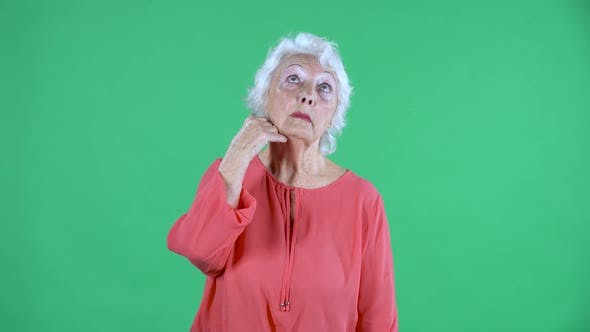 Thumbnail for Portrait Elderly Woman Thinking with Concentration