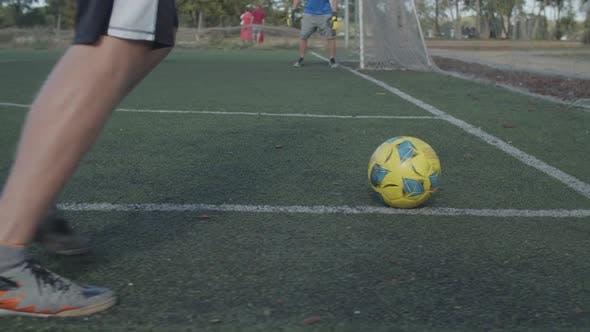 Football Player Kicking Ball on Corner Kick