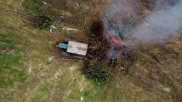 Aerial view tractor push the tree for burn