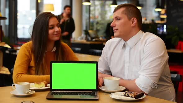 Thumbnail for Happy Couple Talk in Cafe - Coffee and Cake - Computer (Notebook) Green Screen