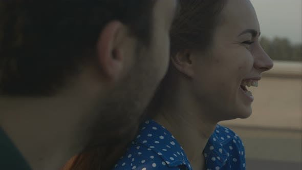 Woman Talks with Man