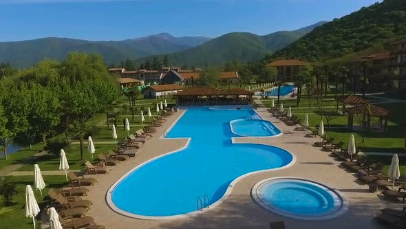 Thumbnail for Luxury Resort Complex With Swimming Pools Surrounded by Caucasus Mountains