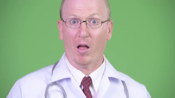 Thumbnail for Mature Bald Man Doctor Looking Shocked