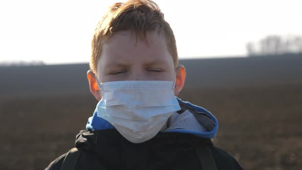 Thumbnail for Portrait of Little Boy with Medical Face Mask Standing Outdoor. Sad Male Child Wearing Protective