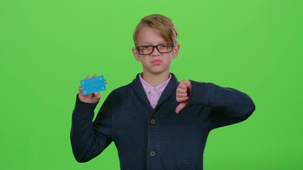 Thumbnail for Child Boy in Glasses with a Credit Card Shows Dislike and Then Like on a Green Screen