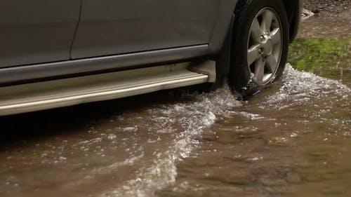 Wheel Car Through Flood Water