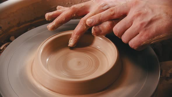 Thumbnail for Pottery - Man with Finger Is Making the Bottom for a Clay Bowl on the Potter's Wheel