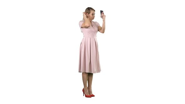 Thumbnail for Beauty woman looking at herself in her smartphone fixing
