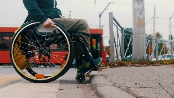 Thumbnail for Disabled Man in Wheelchair Makes Attempt To Climb a Step - Another People Help Him