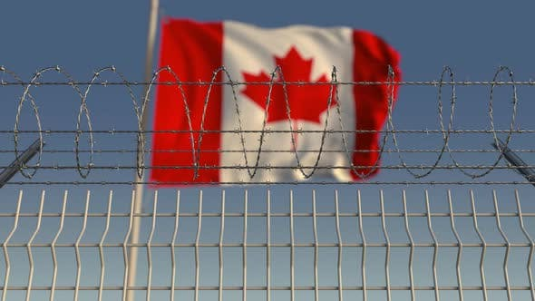 Thumbnail for Barbed Wire Against Waving Flag of Canada