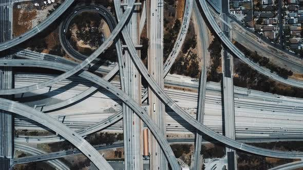 Thumbnail for Drone Top View of Epic Highway Junction Interchange with Traffic Moving Through Multiple Flyovers